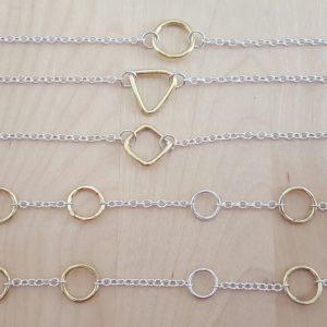 silver and brass ring bracelets