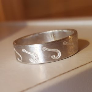 Silver ring with fish hook design
