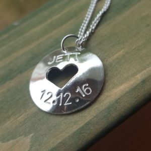 Silver pendant with name and birthday