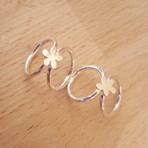 Bespoke handmade silver splint ring with flower design