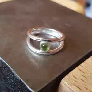 Peridot and silver ring
