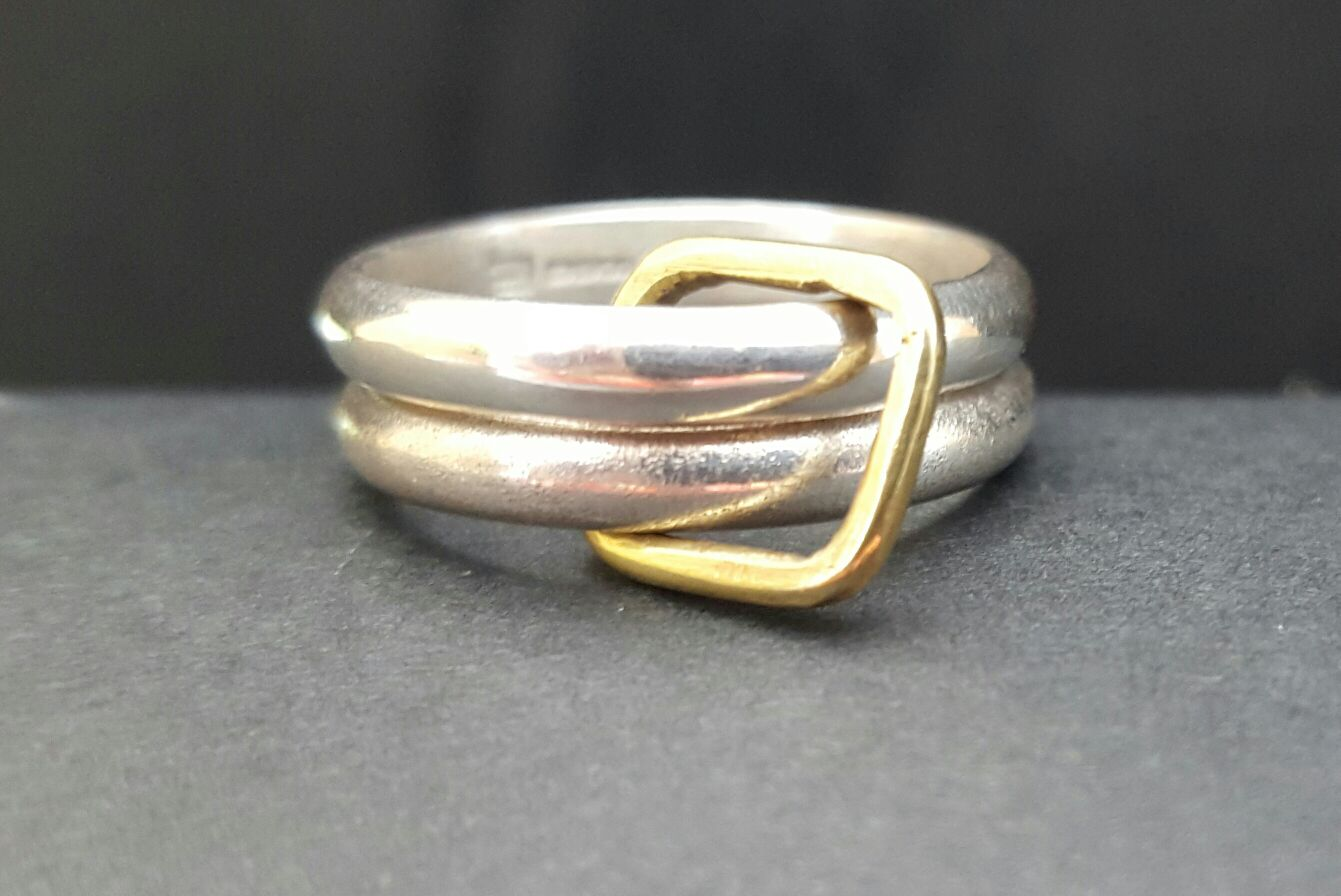 Brass and silver twinned ring