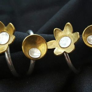 Brass and silver flower and disc rings