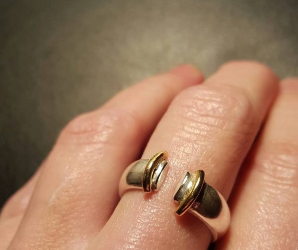 Silver ring with brass detail