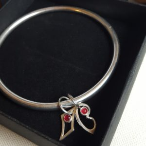 Silver bangle with rubies
