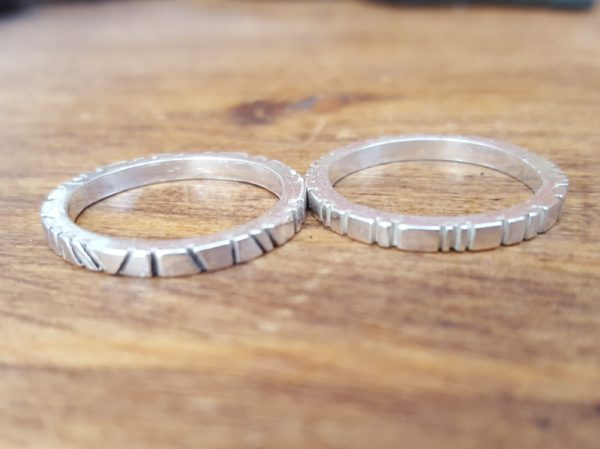Hand made silver cog design rings