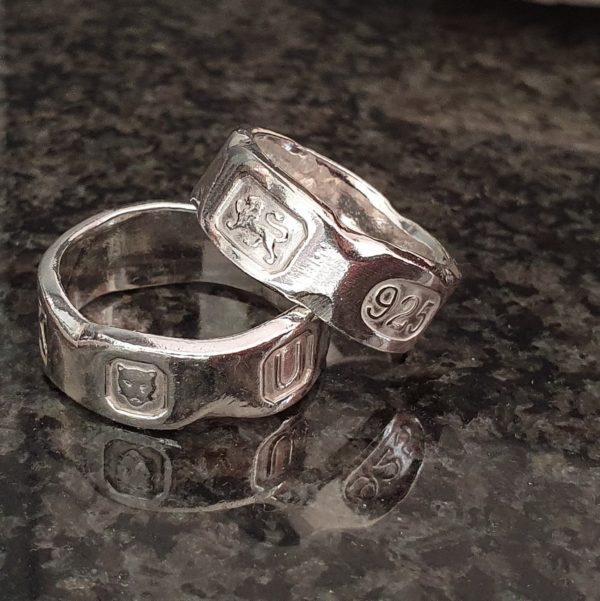 Hallmarked silver rings with a chipped marble effect