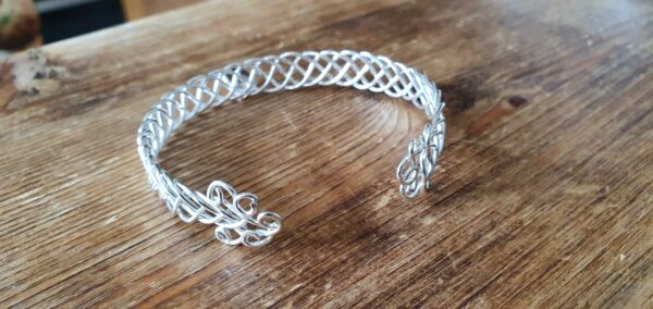 Celtic cuff bangle with initial charm