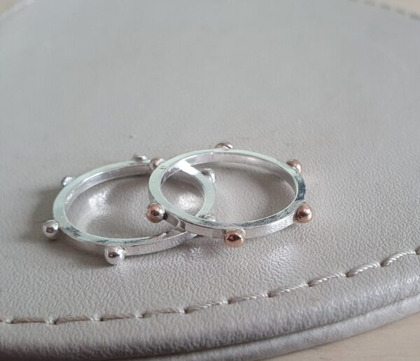 Sterling silver and rose gold studded rings