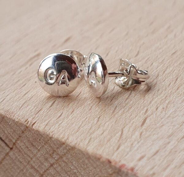 Netball earrings with netball positions